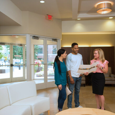realtor showing brochure at Apartment in Wilmington DE