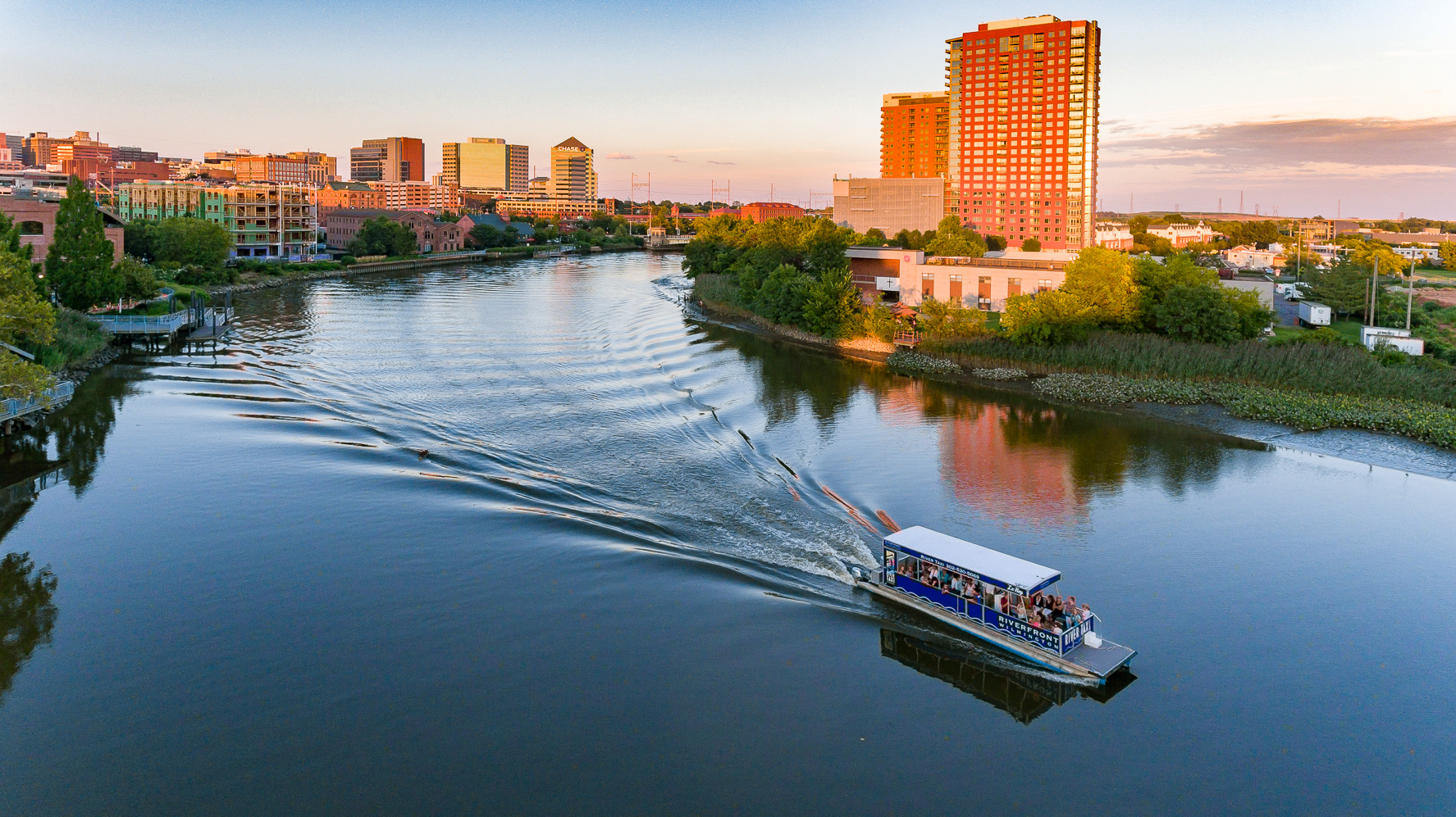 aerial view of boat cruising on river next to Apartment in Wilmington DE